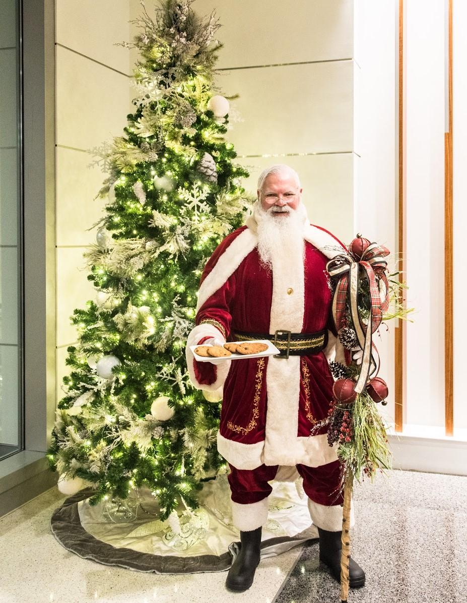Santa standing by tree